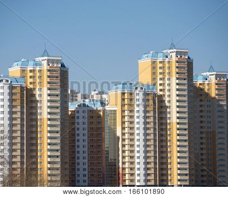 New constructed buildings over blue clear cloudless sky