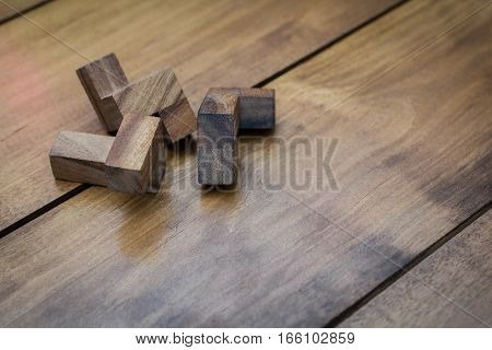 Wooden Block Brain Teaser Puzzle On Wood Background Individual Pieces