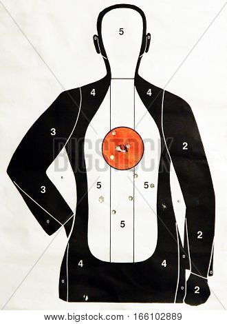 Paper target at the gun ranch after firing practice