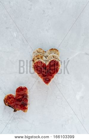 Stack of Heart Shaped Toast with Strawberry Jam on Marble Table