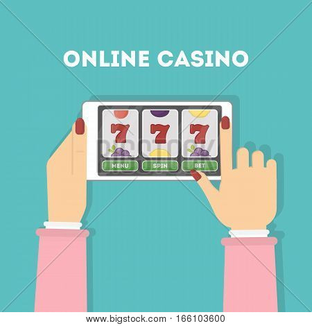 Online casino in the tablet. Hands holding device with gambling game. Gaming addiction. Woman.