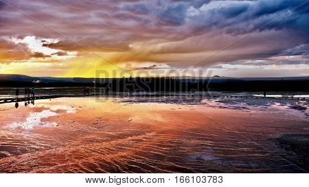 Sunset over steaming geyser Grand Prismatic Sprign. Midway Geyser Basin. Jackson Hole. Wyoming. Unites States.
