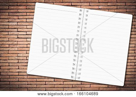 Open notebook paper with line on brick wall background for design with copy space for text or image.