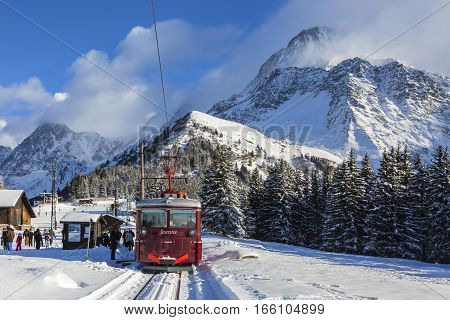 Col de Voza France - December 302014: TheTramway du Mont Blanc reaches the railway station on Col de Voza on 30 December 2014. This is the highest tram in France connecting Saint Gervais with Nid d'Aigle station at the Bionnassay glacier.