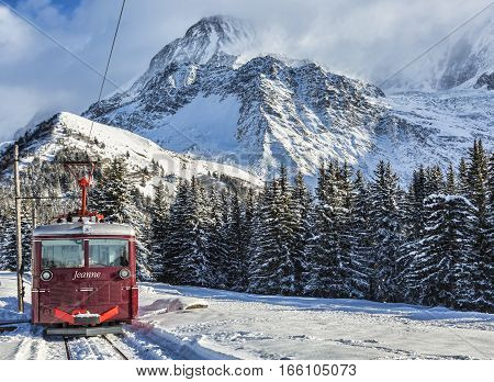 Col de Voza France - December 302014: TheTramway du Mont Blanc reaches the railway station in Col de Voza on 30 December 2014. This is the highest tram in France connecting Saint Gervais with Nid d'Aigle station at the Bionnassay glacier.
