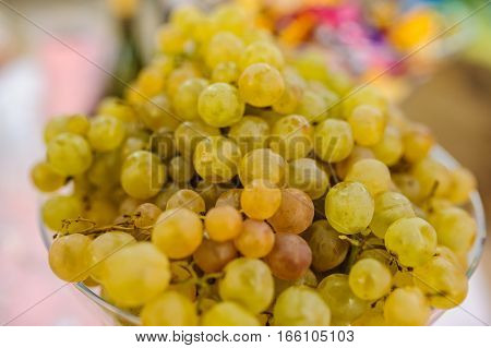green white grapes isolated on the table