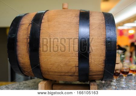 wood old wine barrel with steel ring background