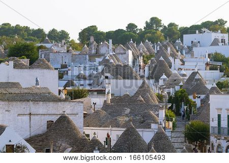View of Alberobello with trulli roofs and terraces Apulia region Southern Italy. Famous Italian landmark. Typical village