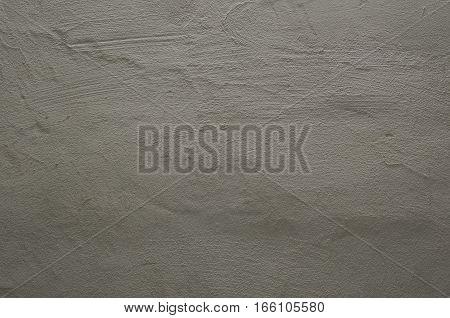 Focused texture of grainy noisy grey wall
