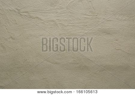 Focused texture of grainy noisy white wall