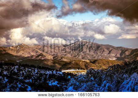 Picturesque landscape with snowy mountain and blue sky. Troodos mountains Cyprus.