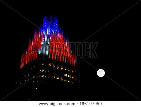 The red and blue lit up brightly on the top of the skyscraper in Charlotte, North Carolina