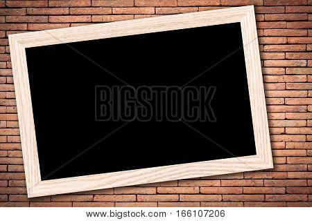 Blackboard or Empty bulletin board with a wooden frame on brick wall background with copy space for text or image.