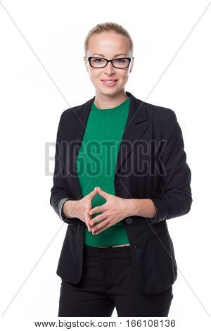 Portrait of beautiful smart young businesswoman in business attire wearin black eyeglasses, standing against white background with arms steeple .