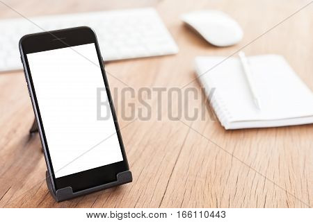 close-up phone mobile blank white screen on holder