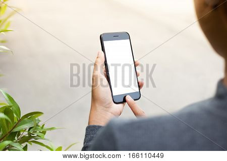 close-up phone mobile in woman hand holding and touch on blank screen new modern people lifestyle