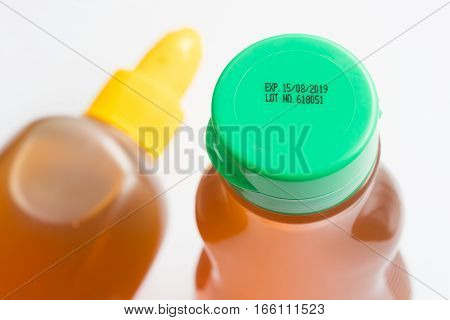 Close - up Expiry date printed on product bottle