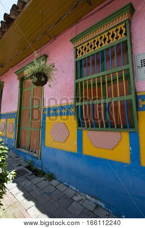 November 13, 2016 Guatape, Colombia: brightly coloured colonial style architecture is the main attraction in the small colonial town