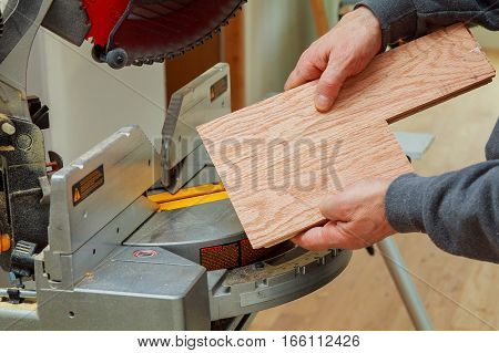 Construction Worker, Trimming Parquet On Using Circular Miter Saw Cutting