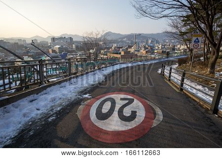 speed limit sign in naksan park road with the view of the seoul city in the background. Taken in Seoul South Korea