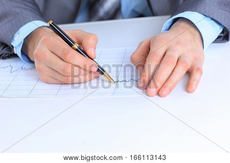 business man working with financial documents  at your Desk.