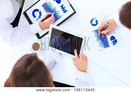 business team working with marketing report on workplace