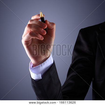 Business man pointing with his pencil forward