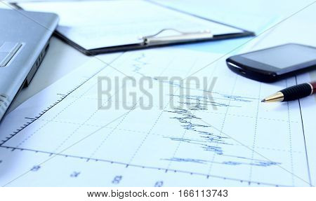 Graphs charts business table. The workplace of business people