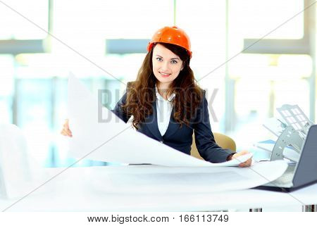 business woman engineer with the work-plan  in  office.