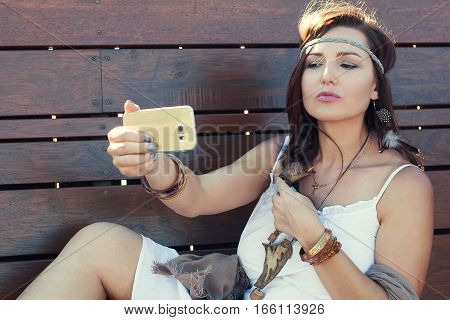 Young woman mobile device selfie boho style beauty