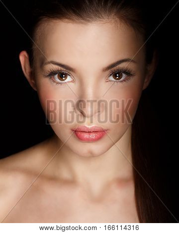 Young attractive woman with clean skin. light make-up concept. Expressive look.