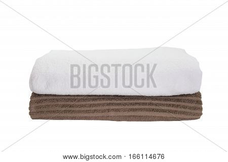 Stack of white towel and brown towel isolated on white background
