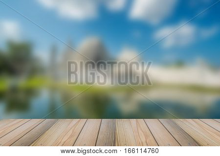Wood floor with blurred white temple background.