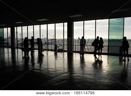 Silhouette people in airpor terminal walk way terrace