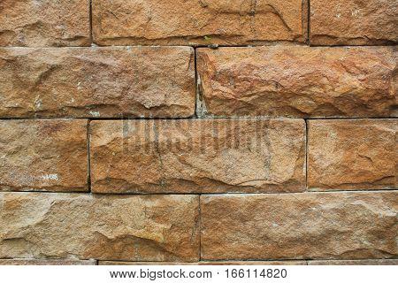 Light earth tone tiled rough bricks wall