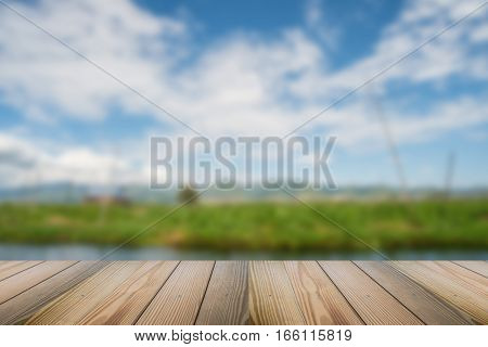 Wood floor with abstract blurred nature background.
