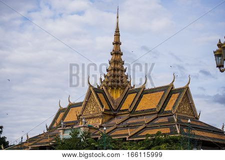 Thai style asian buddhist temple decorated roof.