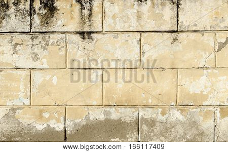 Background of horizontal rows of gray bricks covered with an old gray paint