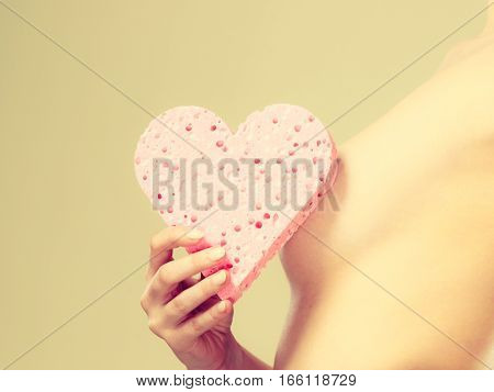 Naked Woman Holding Pink Heart Sponge In Hands.