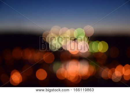 a blur photo of the town lights