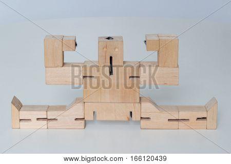 Robot sitting on the splits on white