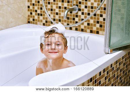 Gay boy takes a bath . Hygiene and body care