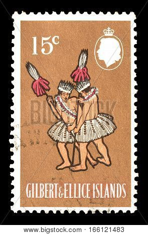 GILBERT AND ELLICE ISLANDS - CIRCA 1965 : Cancelled postage stamp printed by Gilbert and Ellice Islands, that shows Taua Dance.