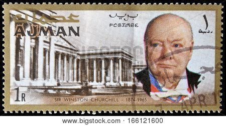 AJMAN - CIRCA 1966 : Cancelled postage stamp printed by Ajman, that shows Winston Churchill and British museum.