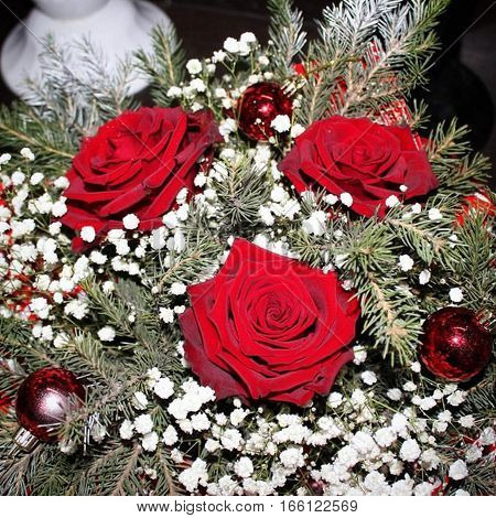 beautiful work florist: winter bouquet of roses and pine branches