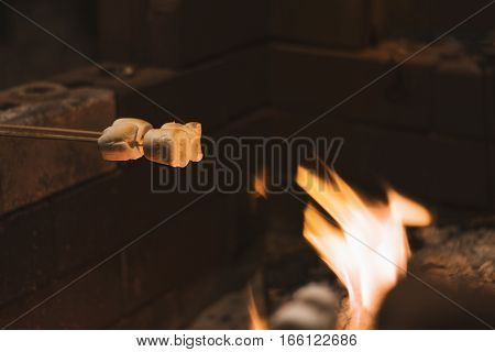 Marshmellow sticks grill on flame fire in Chiangmai festival Thailand