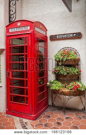 Traditional british old red telephone booth on a street