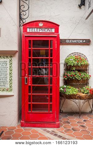 Traditional british red telephone booth on a street