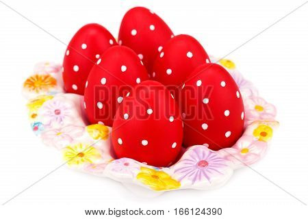 Easter eggs on ceramic setting isolated on white background.