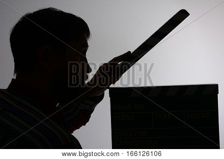 Silhouette Of Man With Clapper Movie.